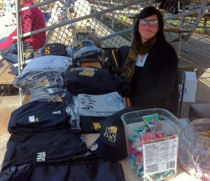 Merchandise table with items and sales girl