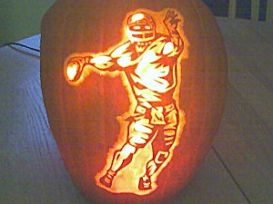 Pumkin carved with football player